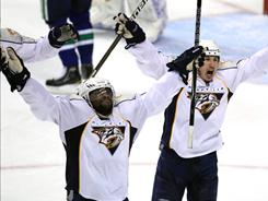Joel Ward, left, scored a pair of third-period goals to help the Predators stave off elimination with a road win over the Canucks.