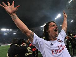 Zlatan Ibrahimovic celebrates AC Milan's after Italian Serie A match against AS Roma in Rome. AC Milan claimed an 18th Serie A title following a 0-0 draw in the match.