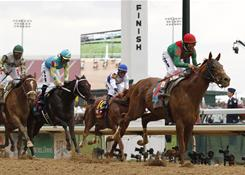 John Velazquez rides Animal Kingdom to victory in the 137th Kentucky Derby at Churchill Downs.