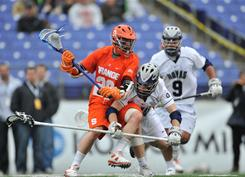 Syracuse attackman Stephen Keogh (28) takes the ball downfield against Georgetown in March in Baltimore.