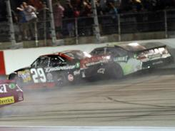 Kevin Harvick (29) and Kyle Busch (18) plow into one another on the wall as Clint Bowyer spins out at the bottom of the track during the final laps of Saturday's race.