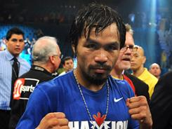 Manny Pacquiao celebrates after defeating Shane Mosley, but the fight lacked any electricity as Pacquiao easily handled Mosley.