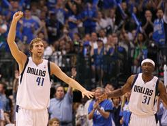 The Mavericks' Dirk Nowitzki (41) celebrates with Jason Terry after a three-pointer in the second quarter of Game 4. Dallas swept the L.A. Lakers to advance to the Western Conference finals.
