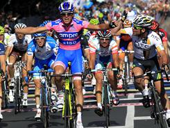 Italy's Alessandro Petacchi celebrates as he outsprints Britain's Mark Cavendish (right) to win the second stage of the Giro d'Italia, from Alba to Parma on May 8.