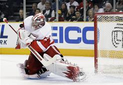 Detroit Red Wings goalie Jimmy Howard stops a shot against the San Jose Sharks during Game 5 of their second round playoff series in San Jose, Calif.