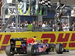 Red Bull driver Sebastian Vettel of Germany crosses the finish line first during the Formula One race at the Istanbul Park circuit.