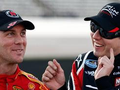 Sprint Cup drivers Kevin Harvick, left, and Kyle Busch got into an altercation at Darlington Raceway on Saturday night. NASCAR officials could dole out penalties on Tuesday.
