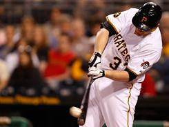 The Pirates' Lyle Overbay connects for an RBI double during a three-run eighth inning Monday. Pittsburgh defeated the Dodgers 4-1.