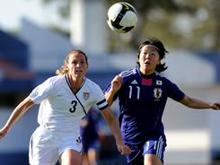 American Christie Rampone competes with Japan's Yuki Nagasato during their Algarve Cup game at Vila Real de Santo Antonio in Portugal on March 2.