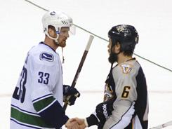 "Predators captain Shea Weber, right, shaking hands with Henrik Sedin, says top-notch defense ""sometimes ... can only get you so far."""
