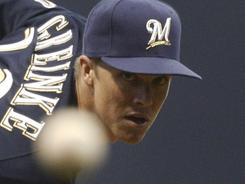 Zack Greinke pitched in front of a Brewers crowd for the first time this season, going six innings and striking out nine in Milwaukee's 4-3 victory.