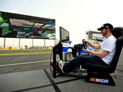 Dale Earnhardt Jr. plays an iRacing simulation game on the new 80-foot tall, 200-foot wide high-definition video board on the backstretch at Charlotte Motor Speedway. The screen was introduced to the public during a news conference Tuesday at the track; it'll make its debut during the May 19-21 Sprint All-Star Race weekend at the 1.5-mile oval.