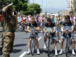 An Italian Bersaglieri corp soldier, left, stands attention as cyclists of the Leopard-Trek team and the rest of the pack observe a moment of silence to honor their teammate Wouter Weylandt, prior to the start of the fourth stage of the Giro d'Italia on May 10.