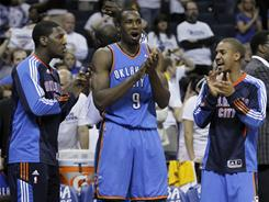 Oklahoma City players Royal Ivey, left, Serge Ibaka, center and Eric Maynor celebrate in the final moments of Game 4 against the Grizzlies, which the Thunder won 133-123 in triple overtime.