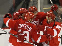 The Red Wings celebrate Valtteri Filppula's game winning goal during the third period.