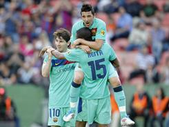 From left, Barcelona's Lionel Messi, David Villa and Seydou Keita celebrate their goal against Levante.