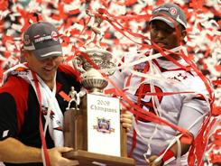 Playoff PAC was formed by a Utah graduate after the undefeated Utes were left out of the 2008 BCS title game. Coach Kyle Whittingham, left, quarterback Brian Johnson and Utah defeated Alabama in the Sugar Bowl that season.