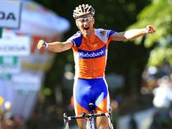 Pieter Weening, of the Netherlands, opens his arms in celebration as he crosses the finish line to win the fifth stage of the Giro d'Italia on May 11.