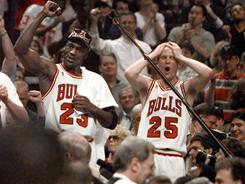 Steve Kerr, right, says there are similarities between his Michael Jordan-led Chicago Bulls of the 1990s and today's Miami Heat.