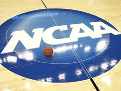 The NCAA logo on the basketball floor of the Jacksonville Veterans Memorial Arena before a 2010 NCAA tournament game.