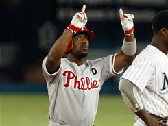 Jimmy Rollins celebrates his two-run single that gave the Phillies a come-from-behind win over the Marlins.