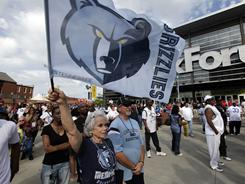 Memphis fan Sonia DiLorio waves a Grizzlies flag outside the FedEx Forum before Game 3 of the first-round series against the Spurs. Memphis hosts the Thunder in Game 6 of the conference semifinals Friday night.
