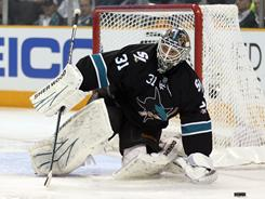 Antii Niemi made 38 saves, including several big stops late in the third period, to help the Sharks close out the Red Wings in Game 7.