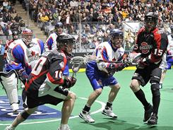 The Toronto Rock (in white) and Washington Stealth, who met in April, will play Sunday for the National Lacrosse League championship.