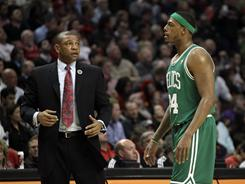 Celtics coach Doc Rivers, left, talking to forward Paul Pierce, is woking on a deal that would keep him in Boston according to an AP source.