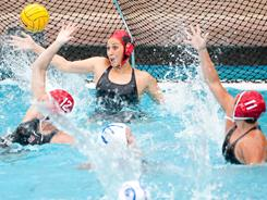 Goalkeeper Amber Oland, center, has helped top seed Stanford allow only 4.73 goals a game this season.