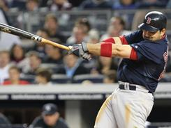 Adrian Gonzalez's fourth home run in the last three games helped the Red Sox hold off the rival Yankees.