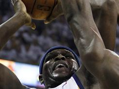 Grizzlies forward Zach Randolph, left, shoots against Thunder forward Serge Ibaka during the first half of Game 6 on Friday night in Memphis. Randolph had 30 points and 13 rebounds as the Grizzlies evened the series at three games apiece.