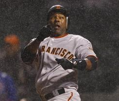 San Francisco Giants shortstop Miguel Tejada loses his bat on a swing against the Cubs during the sixth inning in Chicago.
