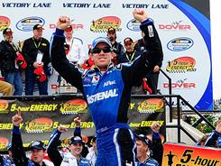 Carl Edwards celebrates his victory in the Nationwide Series race at Dover International Speedway.