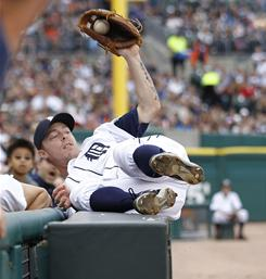 The Detroit Tigers' Brandon Inge catches a foul ball off the bat of the Kansas City Royals' Brayan Pena in Detroit.