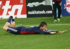 Chivas USA's Justin Braun slides in celebration of his second goal of the first half against the New York Red Bulls in Harrison, N.J.