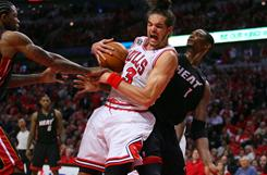Chicago Bulls center Joakim Noah pulls down a rebound in front of Miami Heat forward Chris Bosh during Game 1 of the Eastern Conference finals in Chicago.