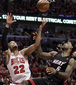 The Chicago Bulls' Taj Gibson, left, and Miami's LeBron James vie for a rebound during Game 1 of the NBA Eastern Conference finals in Chicago.