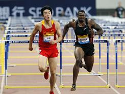 China's Liu Xiang, left, and David Oliver of the United States race to the finish line during the men's 110-meter hurdles during a Diamond League meet on Sunday. Liu won in 13.07 with Oliver close behind at 13.18.