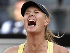 Maria Sharapova celebrates a point during her victory Sunday against Samantha Stosur of Australia in the final of the Italian Open in Rome.