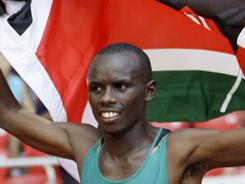 Sammy Wanjiru of Kenya, above celebrating his 2008 gold finish in the men's marathon at the Beijing Games, jumped from a balcony after a dispute with his wife late Sunday night.