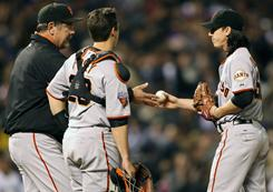 San Francisco Giants pitcher Tim Lincecum is taken out by manager Bruce Bochy in the sixth inning in their game against the Colorado Rockies in Denver.