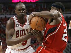 Bulls forward Luol Deng, left, stripping the ball from Hawks guard Joe Johnson during Game 5 of the Eastern Conference semifinals, typically draws the opponents' best perimeter scorer.