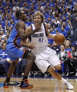 Dallas Mavericks forward Dirk Nowitzki drives past Oklahoma City Thunder forward Serge Ibaka during Game 1 Western Conference finals in Dallas.
