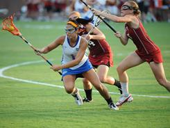 Janine Hillier, left, has 12 goals in her last four games for Florida, including four last week against Stanford in the Gators' NCAA tournament debut.