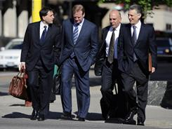 NFL lawyer Jeff Pash, left,  NFL Commissioner Roger Goodell and Art Rooney II, right,  president of the Pittsburgh Steelers arrive for court ordered mediation at the U.S. Courthouse on Tuesday in Minneapolis.