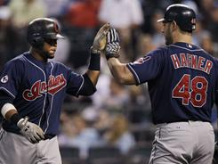 Cleveland Indians' Carlos Santana, left, is congratulated by Travis Hafner (48) after his home run in the fifth inning. Hafner had a 3-run double in the Indians' 7-3 win over the Royals.
