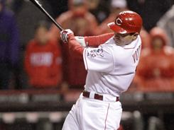 The Reds' Joey Votto hits a double off the Cubs' Kerry Wood to drive in a run in the eighth inning. Votto has 24 RBI in 2011. The Reds won the game 7-5.