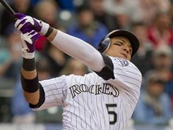 Carlos Gonzalez's eighth-inning two-run single gave the Rockies a lead they would not give up Tuesday. The Rockies beat the Giants 5-3 in Denver.
