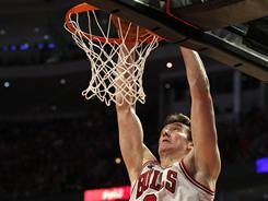 Bulls backup center Omer Asik dunks against the Miami Heat in Game 1 of the Eastern Conference Finals.